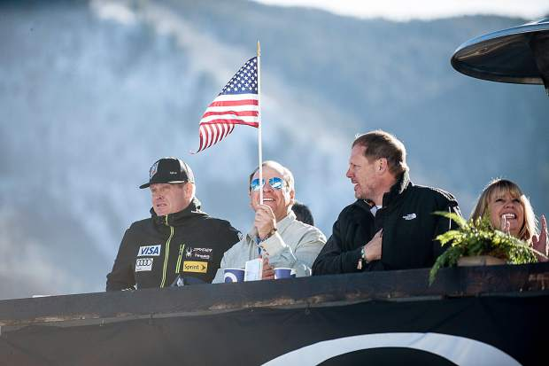 A fan waves his flag in the VIP section on Thursday during the men's and women's Super-G competition on Aspen Mountain.