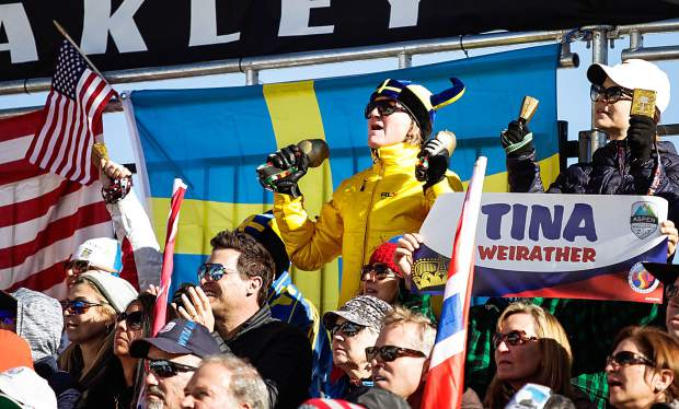 Fans representing countries from around the world go wild for Super G ski racers on Thursday in Aspen.