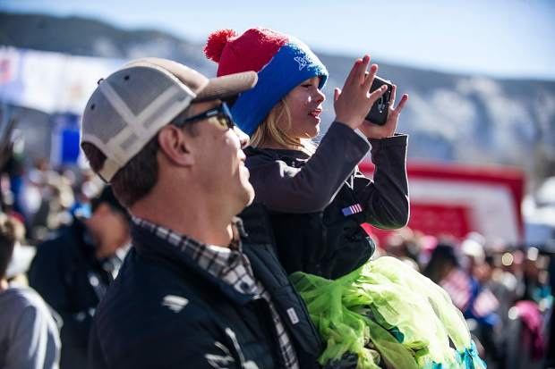 3-yearl-old Valentina Broggi of Fort Collins tries to get a photo of American skier Lindsey Vonn while her dad Mike holds her up at the women's Super-G races on Aspen Mountain on Thursday.