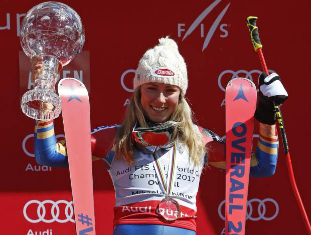 World Cup overall women's 2017 champion United States' Mikaela Shiffrin holds up a crystal globe trophy after a World Cup skiing race Sunday, March 19, 2017, in Aspen, Colo. (AP Photo/Nathan Bilow)
