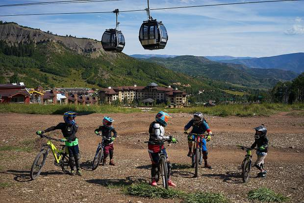 f6732c4bbb0 An instructor takes a break to explain maneuvers to a group of young  students at the Snowmass bike park in August. Jim Paussa/special to The  Aspen Times