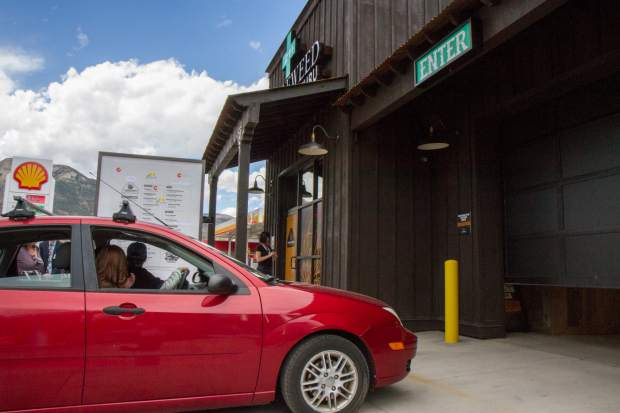 The first car rolls through the drive-through during the grand opening of the Tumbleweed Express Drive-Thru.