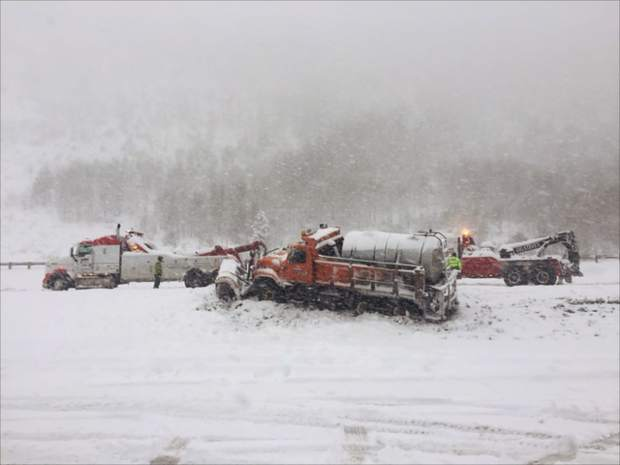 A snow plow slid off the road and required assistance from a pair of tow trucks on Thursday near the East Vail exit.