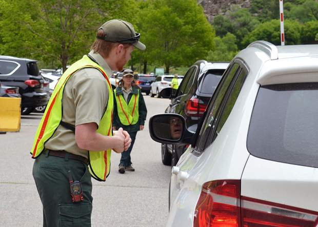 The front lines in the battle for Hanging Lake are in the parking lot. The White River National Forest typically has six staffers manning Hanging Lake Trail on the busiest summer weekends, but four of them stick to the parking lot to manage vehicle logistics.