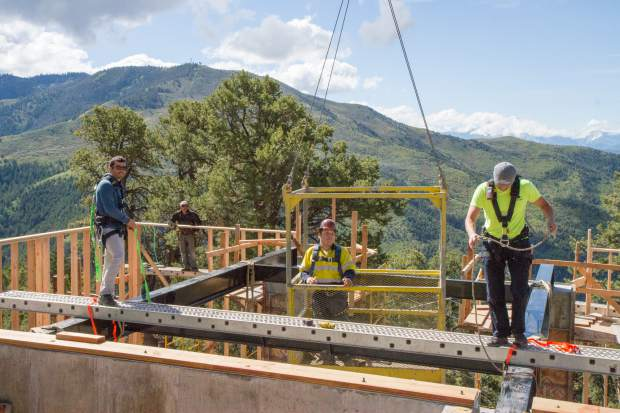 Crews continue work to install the new Haunted Mine Drop on-site at the Glenwood Adventure Park.