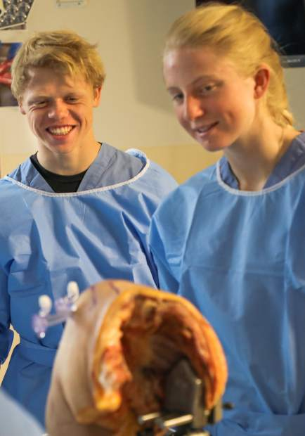 Campbell Sullivan and Teddy Kust examine the human shoulder cadaver on Tuesday in Vail.