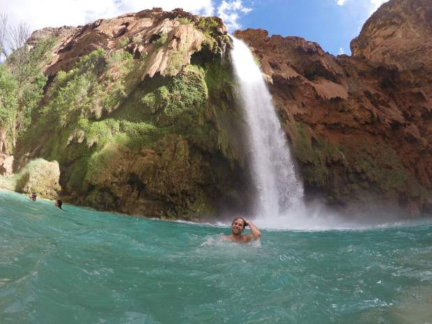 Austin Maring, of Mid-Valley Paint & Property Services, enjoys a swim underneath Havasu Falls after the 10-mile hike in.