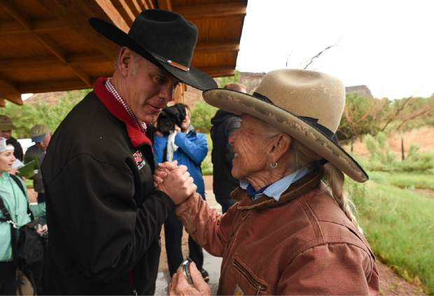 U.S. Interior Secretary Ryan Zinke, left, thanks Heidi Reed during his visit to historic Dugout Ranch along Indian Creek near Monticello, Utah, operated by Redd, under a conservation easement with the Nature Conservancy.