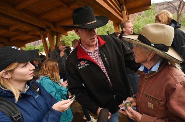 U.S. Interior Secretary Ryan Zinke, center, thanks Heidi Reed during his visit to historic Dugout Ranch along Indian Creek near Monticello, Utah, operated by Redd, under a conservation easement with the Nature Conservancy. Zinke is touring two monuments in Utah this week as part of a review ordered by President Donald Trump of 27 monuments to determine if they were properly designated.