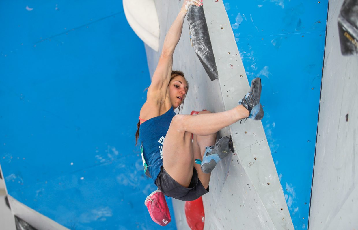 AlexPuccio of the U.S. makes her way up the first route of the International Federation of Sport Climbing for the GoPro Mountain Games on Saturday in Vail.