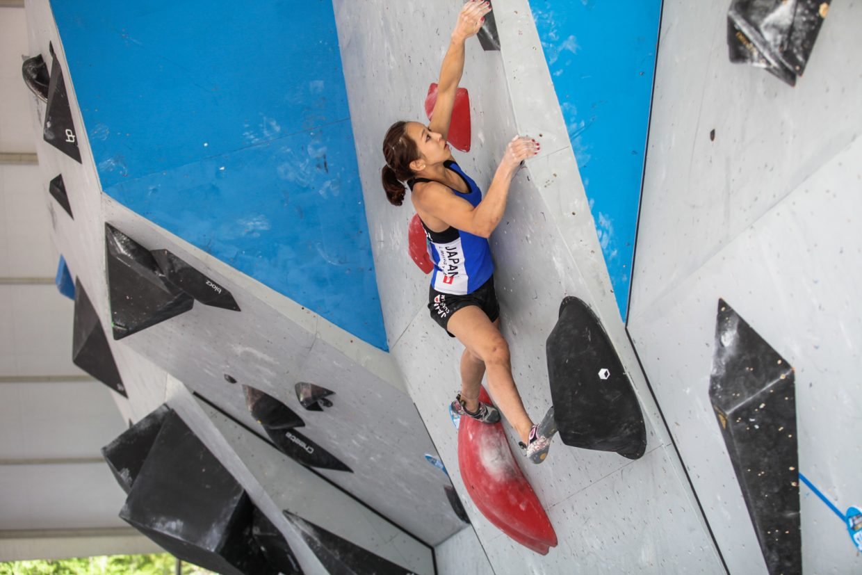 Akiyo Noguchi of Japan makes her way up the bouldering wall for the International Federation of Sport Climbing finals for the GoPro Mountain Games on Saturday in Vail.