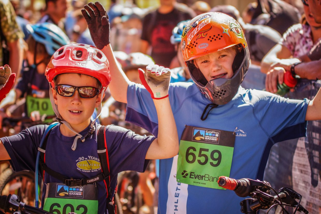 From left, Davis Place, 8, and Jackson Fitzgerald, 8, at the start line of the Kids Mountain Bike Competition for the GoPro Mountain Games at Golden Peak on Saturday in Vail.