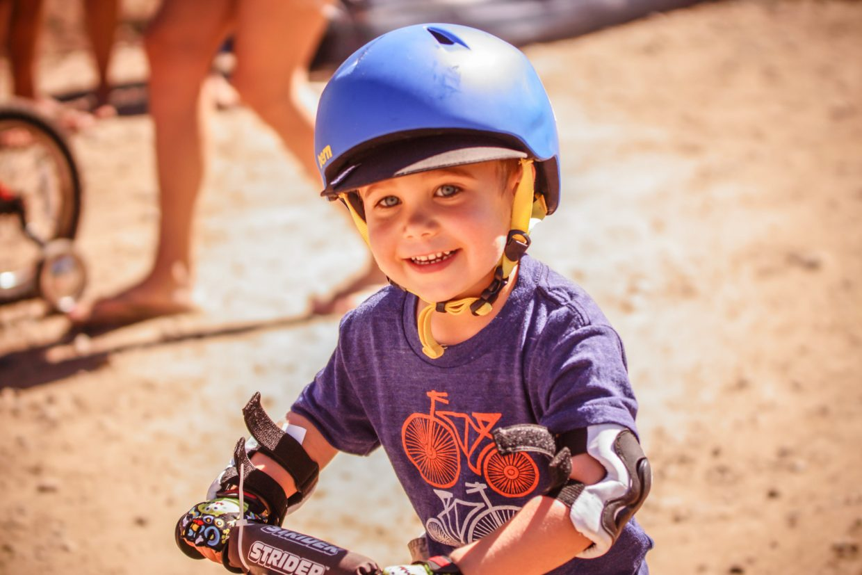 Ollie Michalchuk, 3, of Denver competes in the Kids Mountain Bike Competition at Golden Peak on Saturday in Vail.