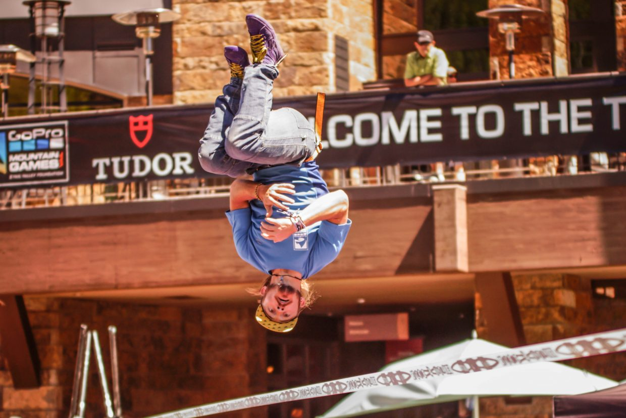 Vail native, Mickey Wilson, eyes his landing during the Slackline Invitational on Saturday in Vail.