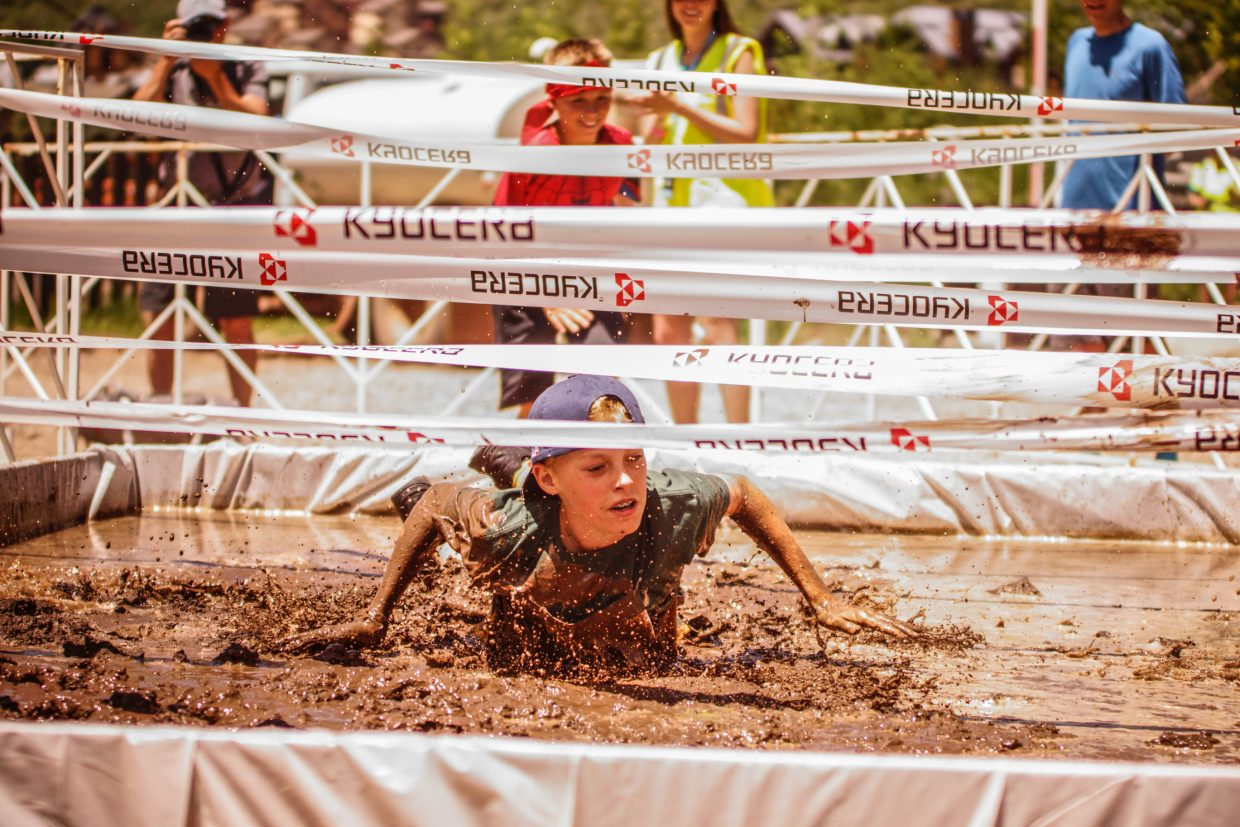 The first competitor dives in the mud during the Volvo Mountain Kids and Family Mud Run near Gondola One on Saturday in Vail.