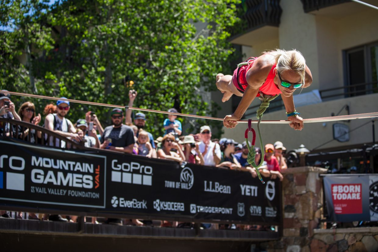 Heather Larson of Salt Lake City shows off her slackline skills at the GoPro Mountain Games on Saturday in Vail. Hundreds of professional and recreational athletes gathered in Vail over the weekend to compete.