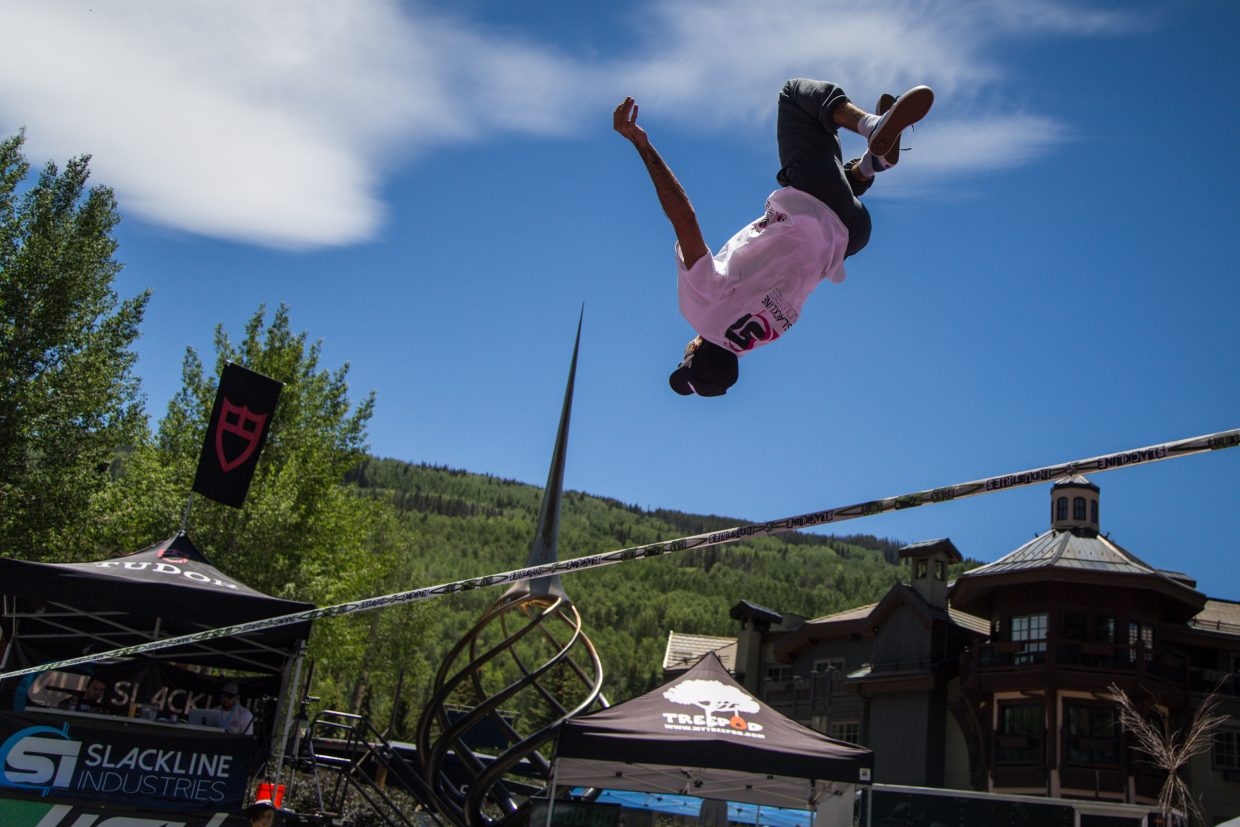 Mauricio Sant'anna of Brazil executes a flip on a slackline during a demonstration at the GoPro Mountain Games on Saturday in Vail. Skiill levels from novice to expert were respresented in varying sports and competitions.
