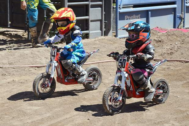 No. 4 Hayden Hyslop, 4, of Edwards, crosses the finish line for the win in the electric minibike class at Moto Mayhem at the Eagle County Fairgrounds on Saturday.