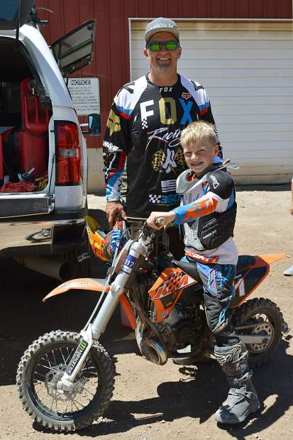 No. 51 Hugh Tarrant with father Steve in the pits preparing for the 50cc 7- to 12-year-old age class at Moto Mayhem at the Eagle County Fairgrounds on Saturday.