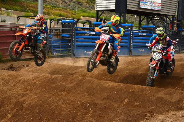 No. 46 Dan Smitley, of Gypsum, and No. 69 Windham Miller, of Edwards, battle for the hole shot through the whoops section at the start of the Open Two-Stroke Class at Moto Mayhem at the Eagle County Fairgrounds on Saturday.