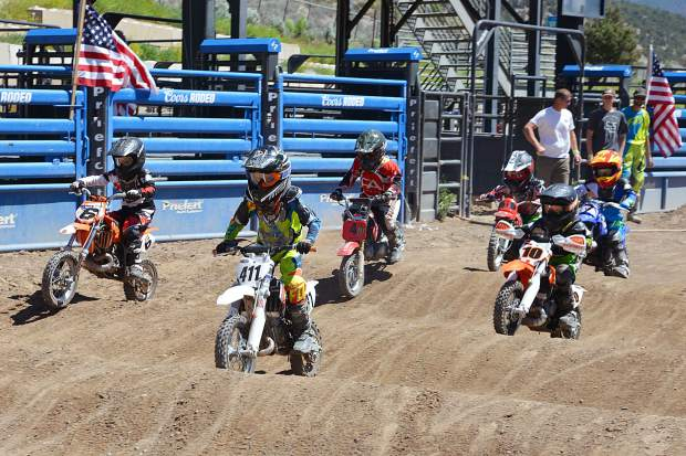 Riders battle through the whoops section of the 4- to 6-year-old minibike class at Moto Mayhem at the Eagle County Fairgrounds on Saturday.