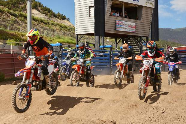 No. 17 pro racer Nicole Bradford, of McCoy, pulls the hole shot to the first turn at the start and runs away with the win ahead of No. 732 Jaime Jam Thunder, of Avon, in the Women's Class at Moto Mayhem at the Eagle County Fairgrounds on Saturday.