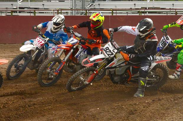 No. 17 Nicole Bradford, of McCoy, battles through the corner between No. 607 Spencer Ball, of Avon, and Travis Hyslop in the 30-plus Open Class. Bradford took the class win, with Travis in second at Moto Mayhem at the Eagle County Fairgrounds on Saturday.