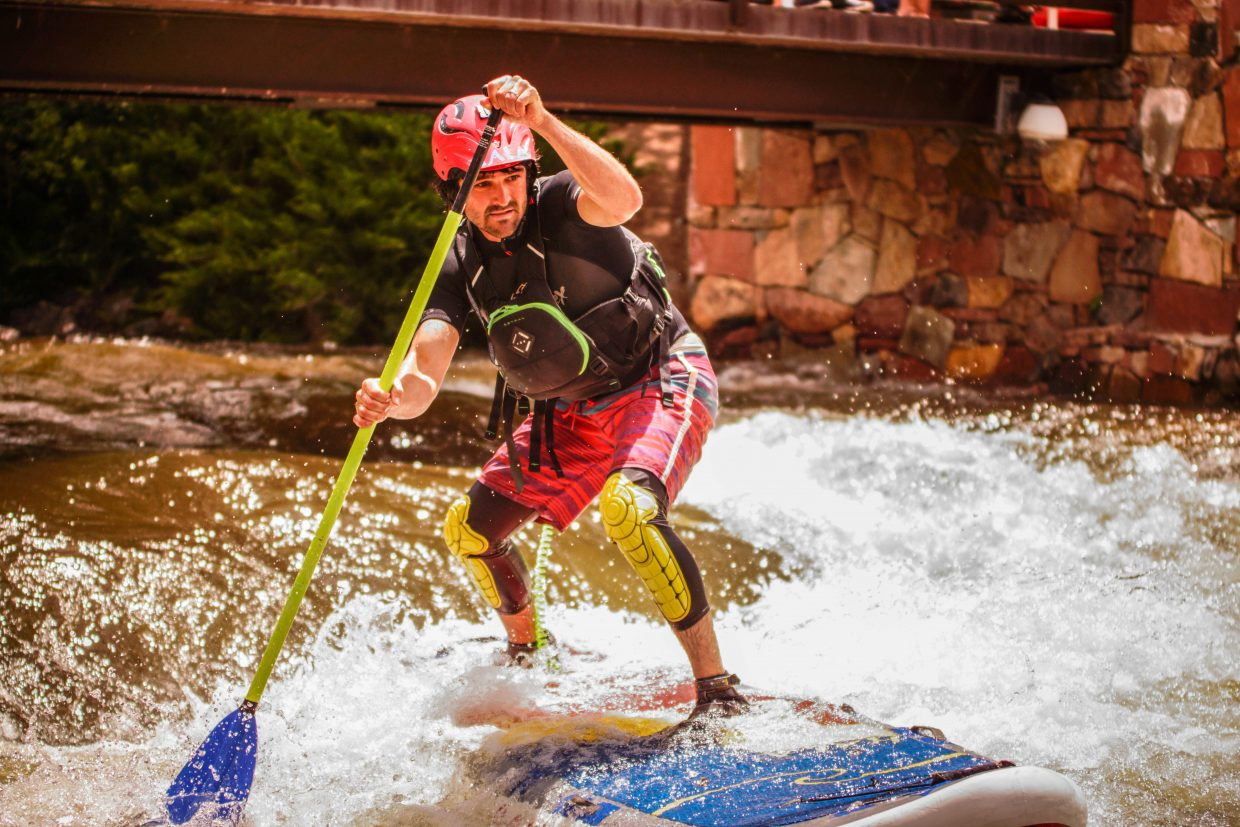 Peter Hall of Steamboat competes in the SUP Cross Qualifer on Sunday in Vail.