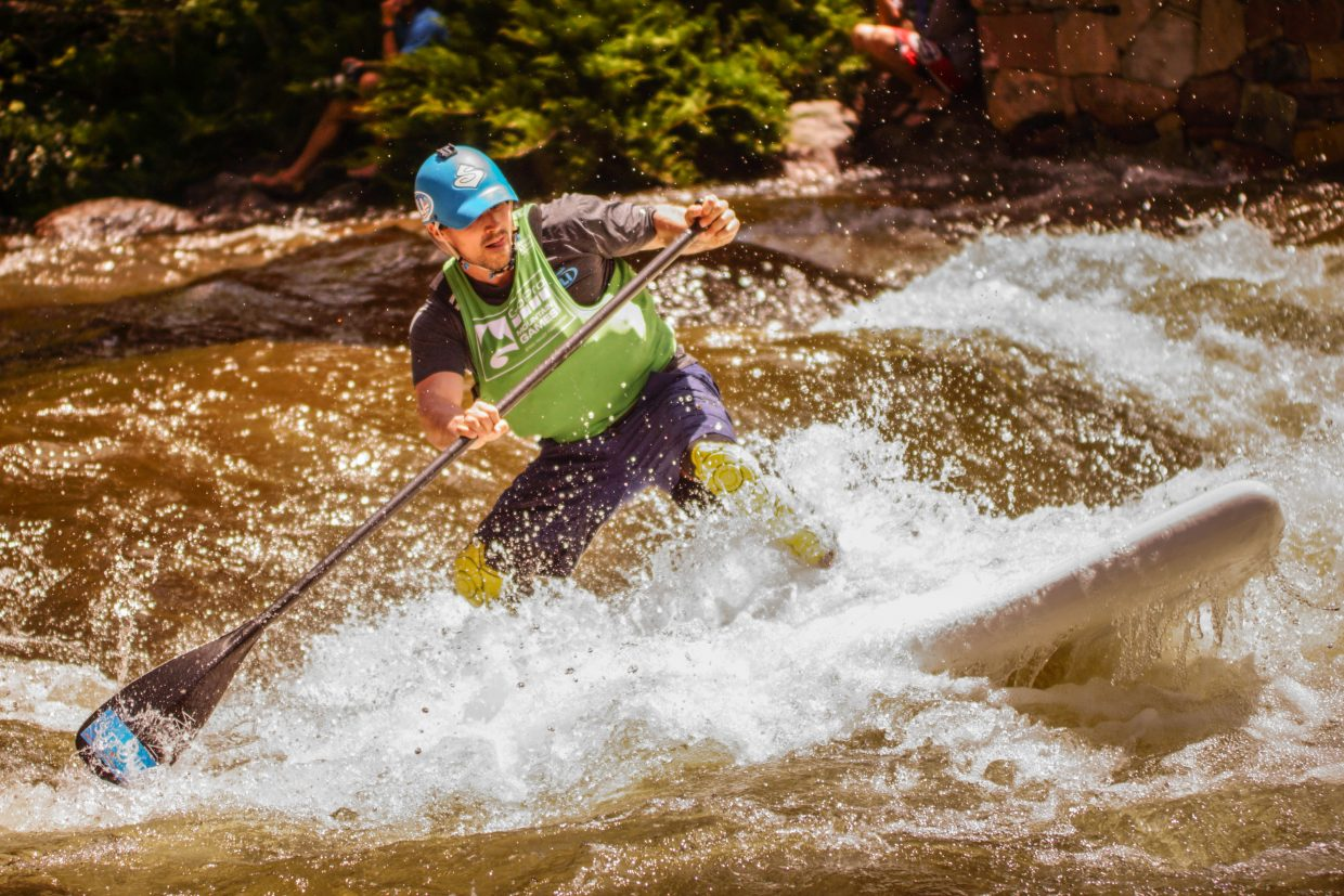 Ian Smith pushes out of a rapid during the SUP Cross competition on Sunday in Vail.
