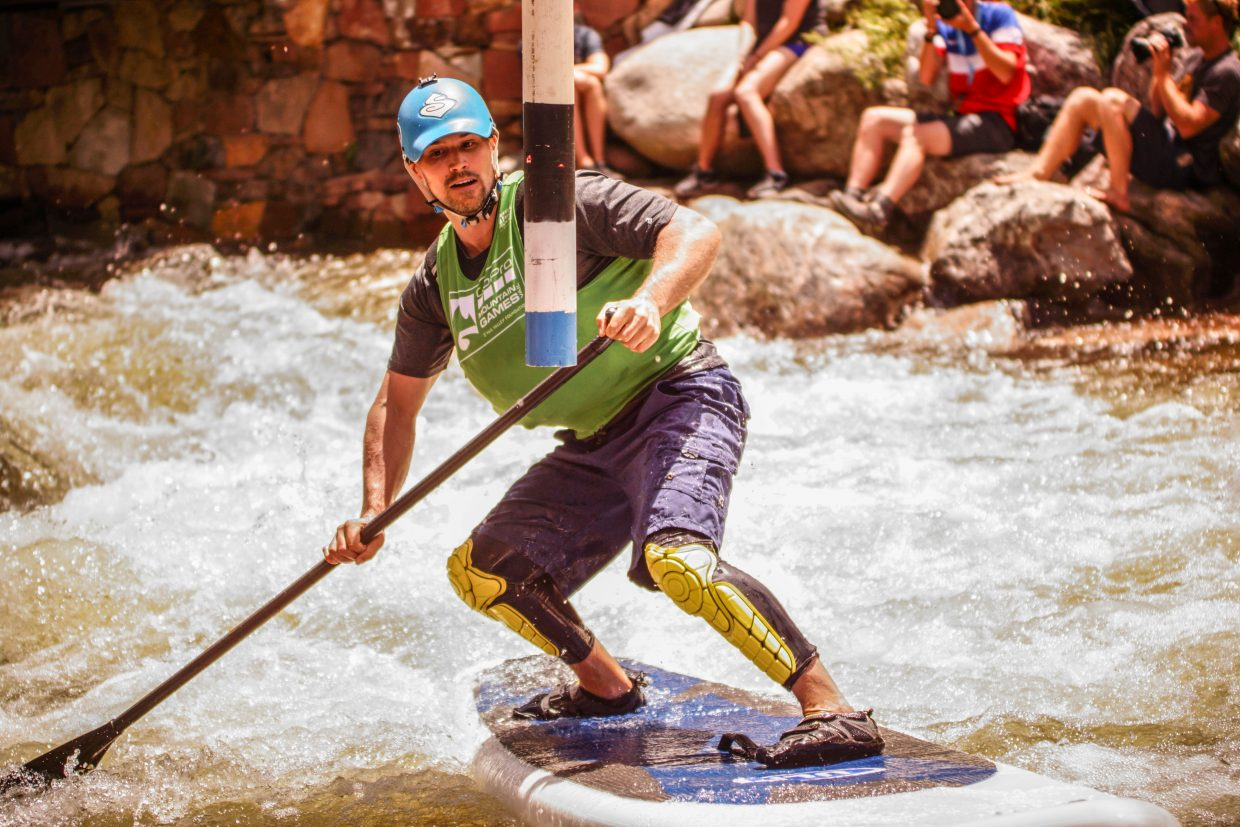 Ian Smith turns around the gate during the SUP competition on Sunday in Vail.