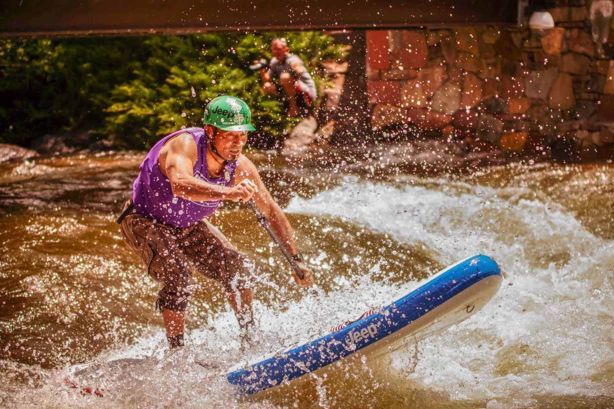 Yaku of Japan charges through the rapid during the SUP Cross compeition on Sunday in Vail.