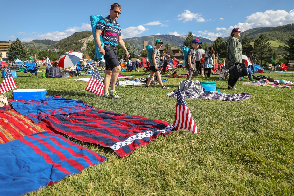 Families search for spots in Nottingham Park during the Westin Salute to the USA event Monday, July 3, 2017, in Avon. The annual celebration in Avon takes place the day before July 4.