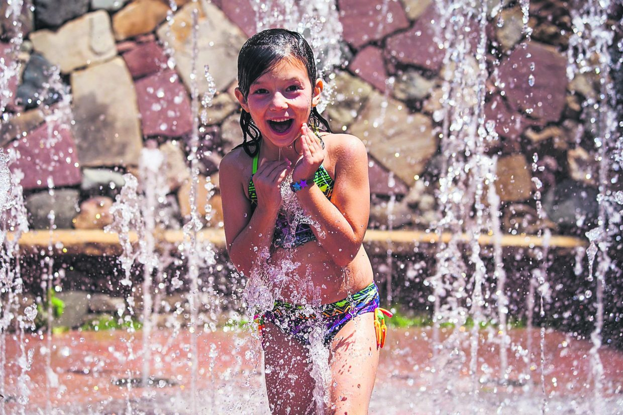 Six-year-old Savannah Parish, from St. Augustine Florida, squeals with delight as water spouts around her on the Beaver Creek splash pad on Friday afternoon. With the recent high temps and dry weather, the splash pad provides a great way for kids to cool down.