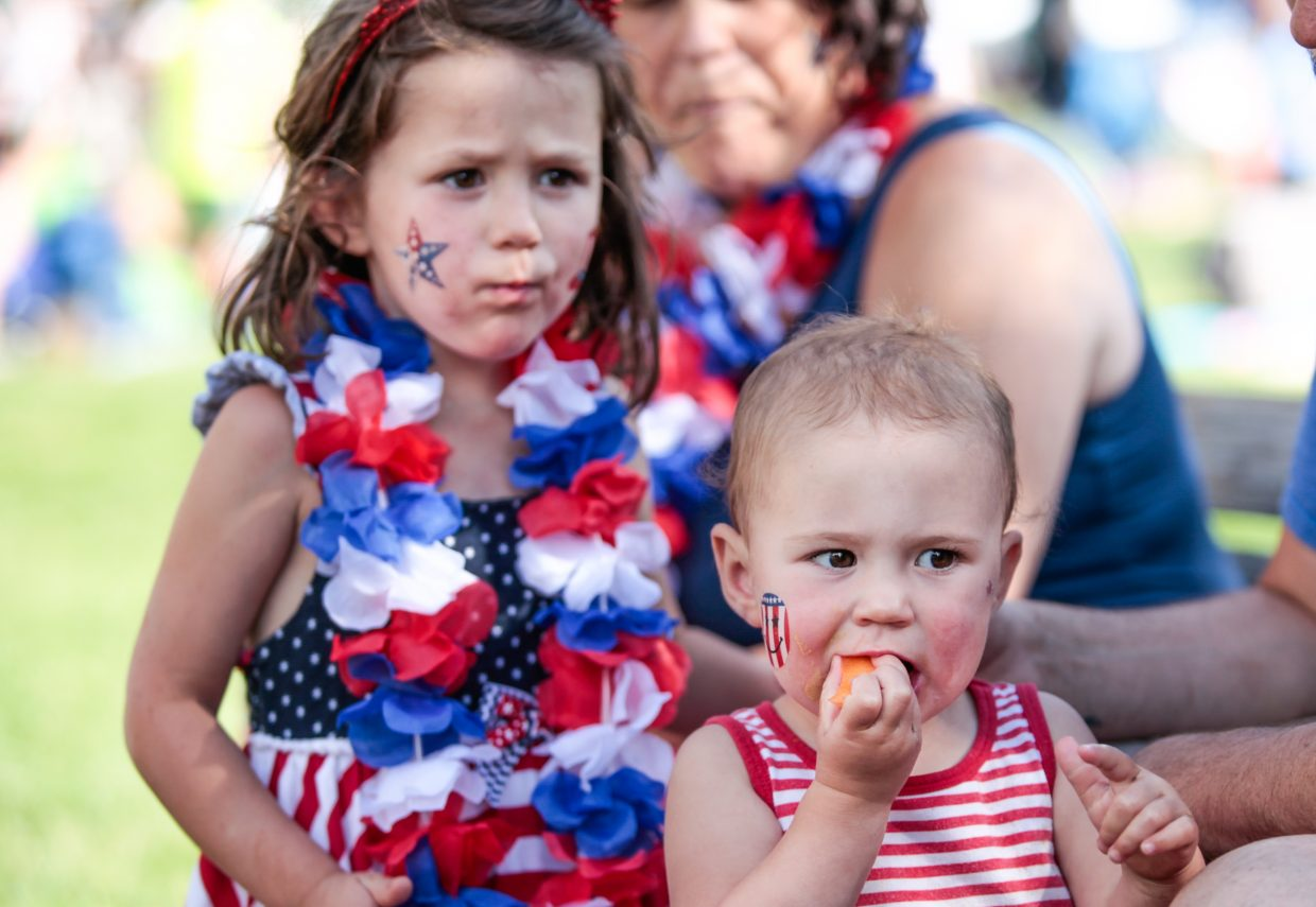 Esther, 1, and Nadia Grove, 4, of Missouri, chow down on cantaloupe during Westin Salute to the USA on Monday in Avon. The annual celebration featured a kid's zone, live music, including the Colorado Pops Orchestra and fireworks to close the night out.