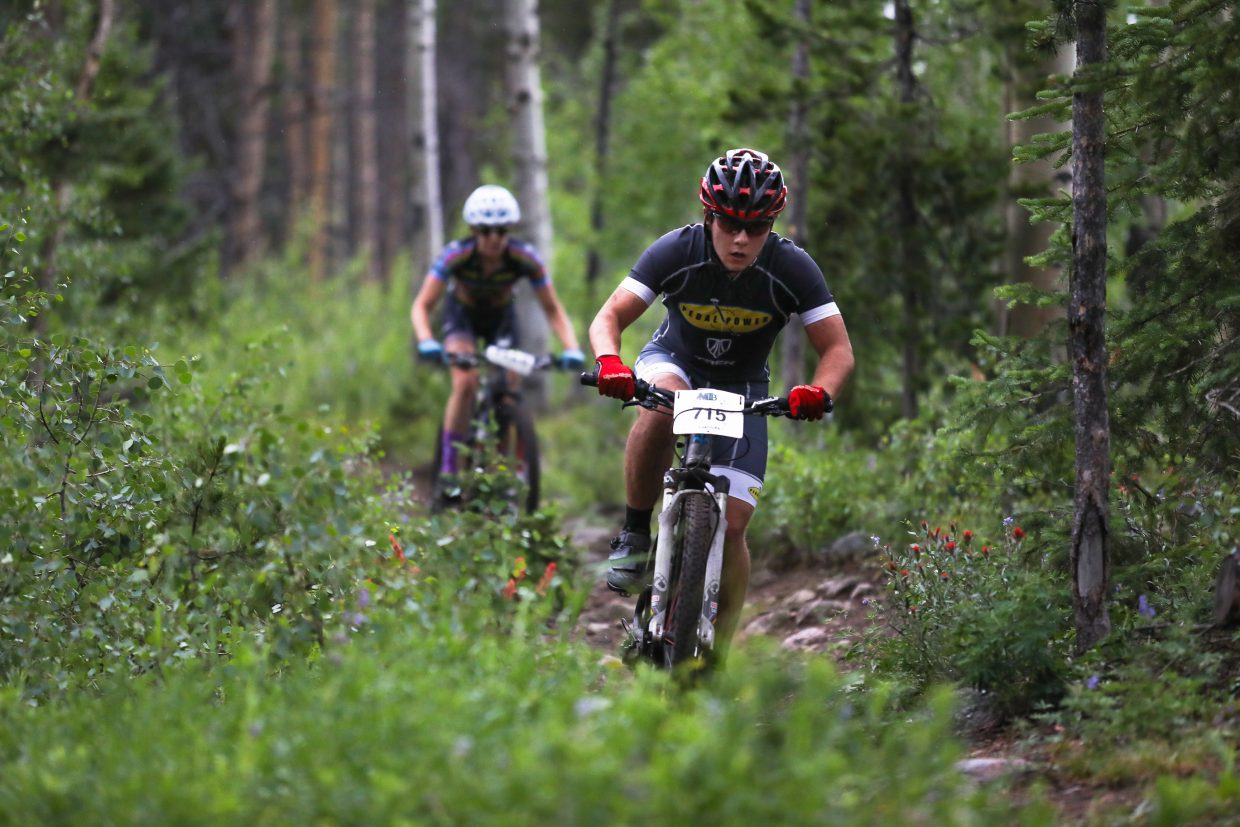 Riders make their way down Lost Lake Trail for the Lost Lake Loop bike race through the Vail Recreation District on Wednesday in Vail. The race hasn't been held on that course in 10 years.