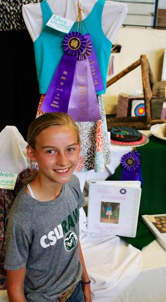 Aubrey Winstead, 11, of Eagle shows off the Grand Champion ribbon attached to her sewing project. She found the great ribbon surprise when she visited the exhibit hall Wednesday morning. Open class and 4-H exhibits are on display at the exhitbit hall from 9 a.m. to 8 p.m. daily through Saturday at the Eagle County Fiar & Rodeo.