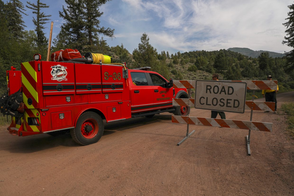 Crews head up to the Gutzler Fire Thursday near State Bridge. Forest Service Road 402 is now closed due to the size of the fire.