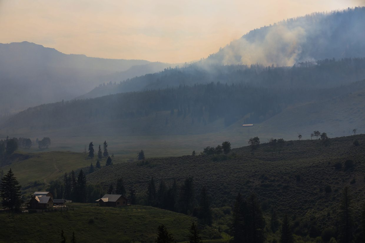 The Gutzler Fire burns north of State Bridge on Thursday off of U.S. Forest Road 401. Smoke is causing haziness, which has promted a health warning.