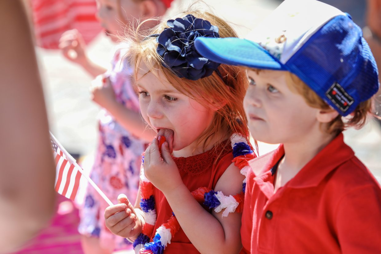 Luki Stecher, 2, (right) and Leilani, 3 of Avon enjoy candy thrown during the July 4 parade for Vail America Days on Tuesday in Vail. Warm and sunny weather accompanied the parade.