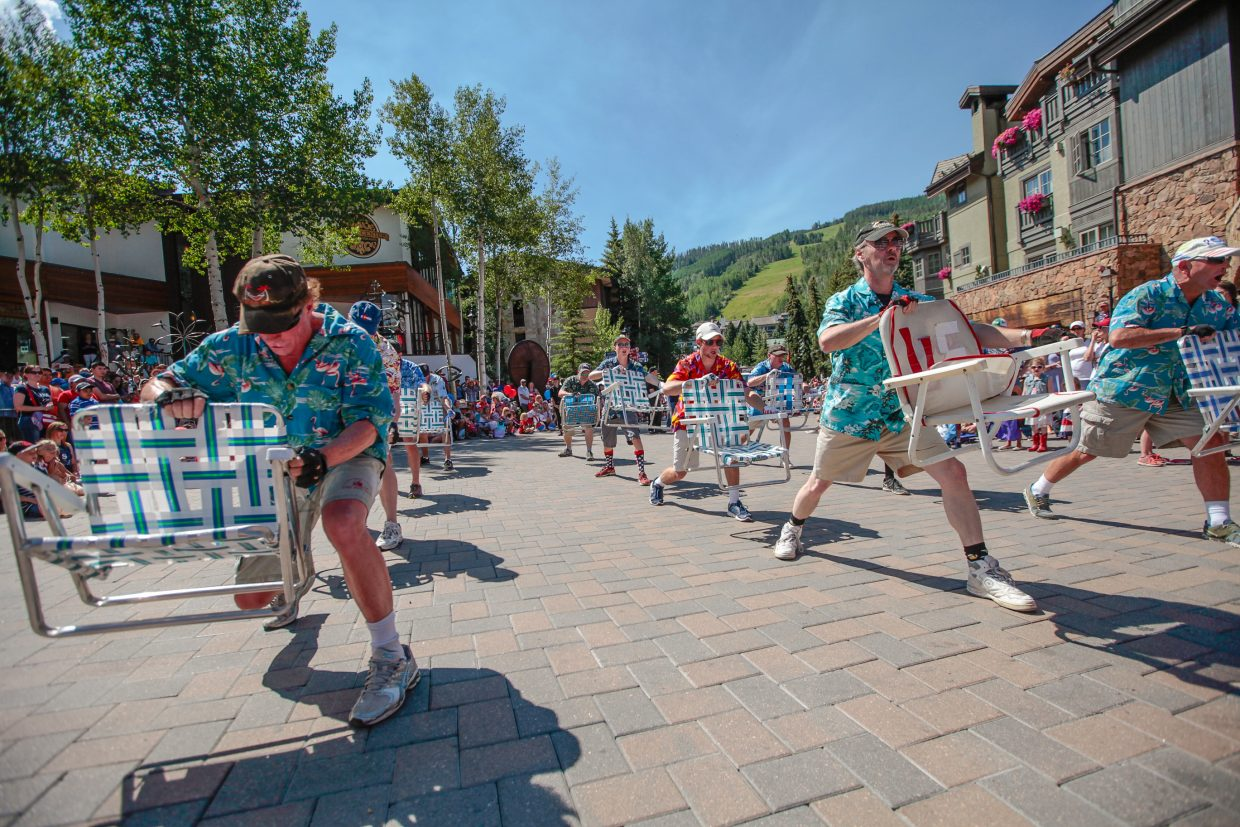 Vail Precision Lawn Chair Demonstration Team performs during the July 4 parade for Vail America Days on Tuesday in Vail. More than 60 floats/groups took part in the parade.