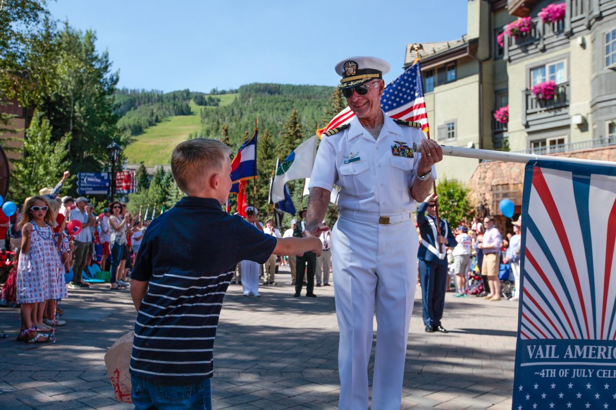 A boy shakes a veteran's hand during the Vail America Days July 4 Parade Tuesday, July 4, in Vail.