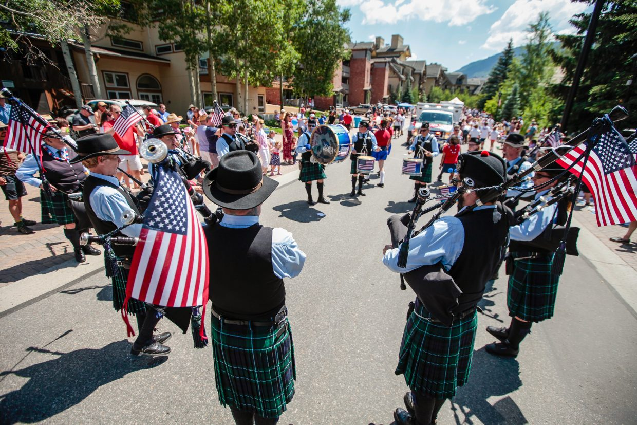 Denver District Pipe Band performs for the crowd during July 4 parade for Vail America Days on Tuesday in Vail. The parade stretched from Golden Peak to Lionshead in Vail, drawing thousands of spectators.