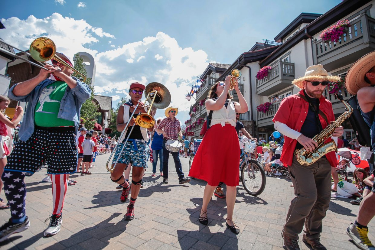 The Gora Gora Orchestra gets the crowd to its feet during the July 4 parade for Vail America Days on Tuesday in Vail. Getting people on their feet wasn't hard for the eclectic orchestra.