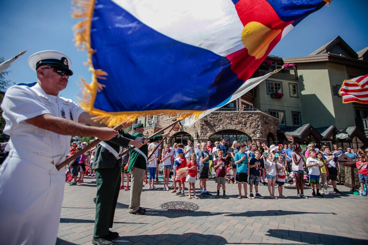 VFW Post 10721 - Flag Honor Guard pause for the National Anthem at the start of the July 4 parade for Vail America Days on Tuesday in Vail.