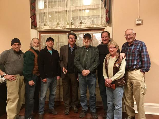 Several members of the Glenwood Springs Historical Society and Frontier Museum gathered to see Doc Holliday's derringer at the Hotel Colorado. They are Mike Miller, Holliday expert R. W.