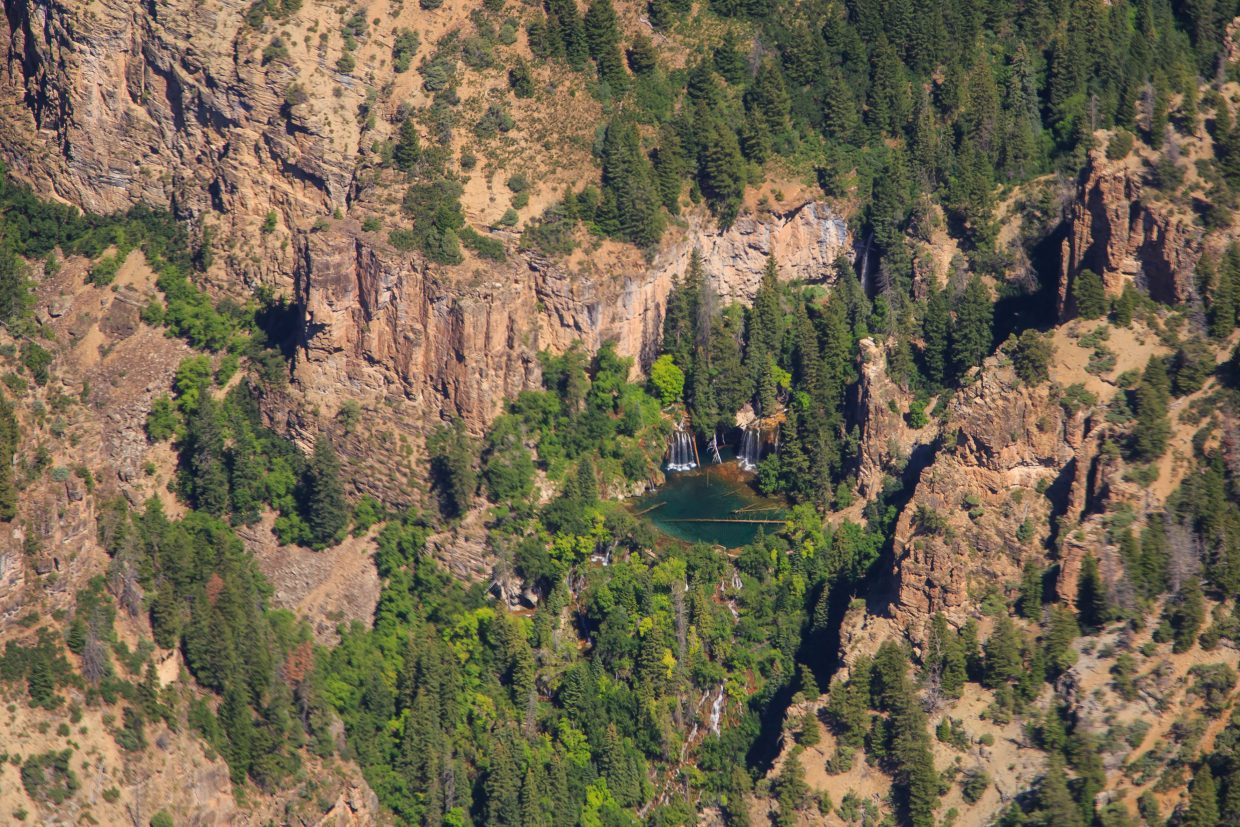 Hanging Lake from the air appears to be a beautiful oasis of solitude. Currently under scrutiny for the careless treatment by visitors and the ever increasing popularity as a day-hike, its future of availability to the public is up in the air.