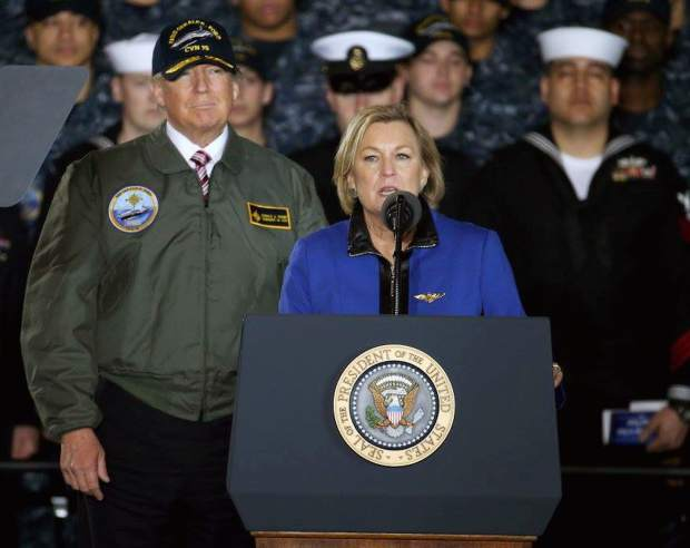 Susan Bales Ford, sponsor of Pre-Commissioning Unit Gerald R. Ford introduces President Donald J. Trump as they met with sailors and shipbuilders.