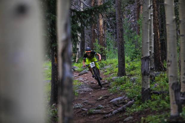 Riders make their way down Lost Lake Trail for the Lost Lake Loop bike race through the Vail Recreation District on Wednesday, July 12, 2017, in Vail.