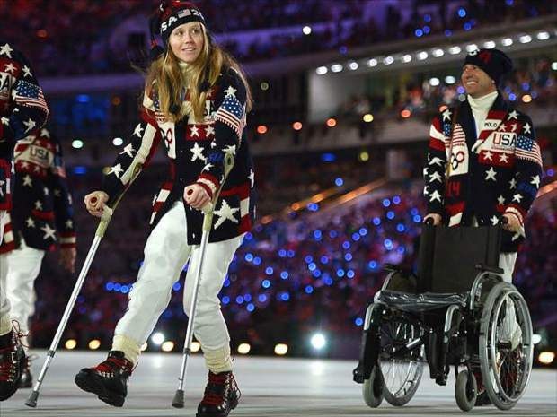 Heidi Kloser joined her American teammates in the 2014 Olympic Games Opening Ceremonies parade, albeit hobbling along on crutches.