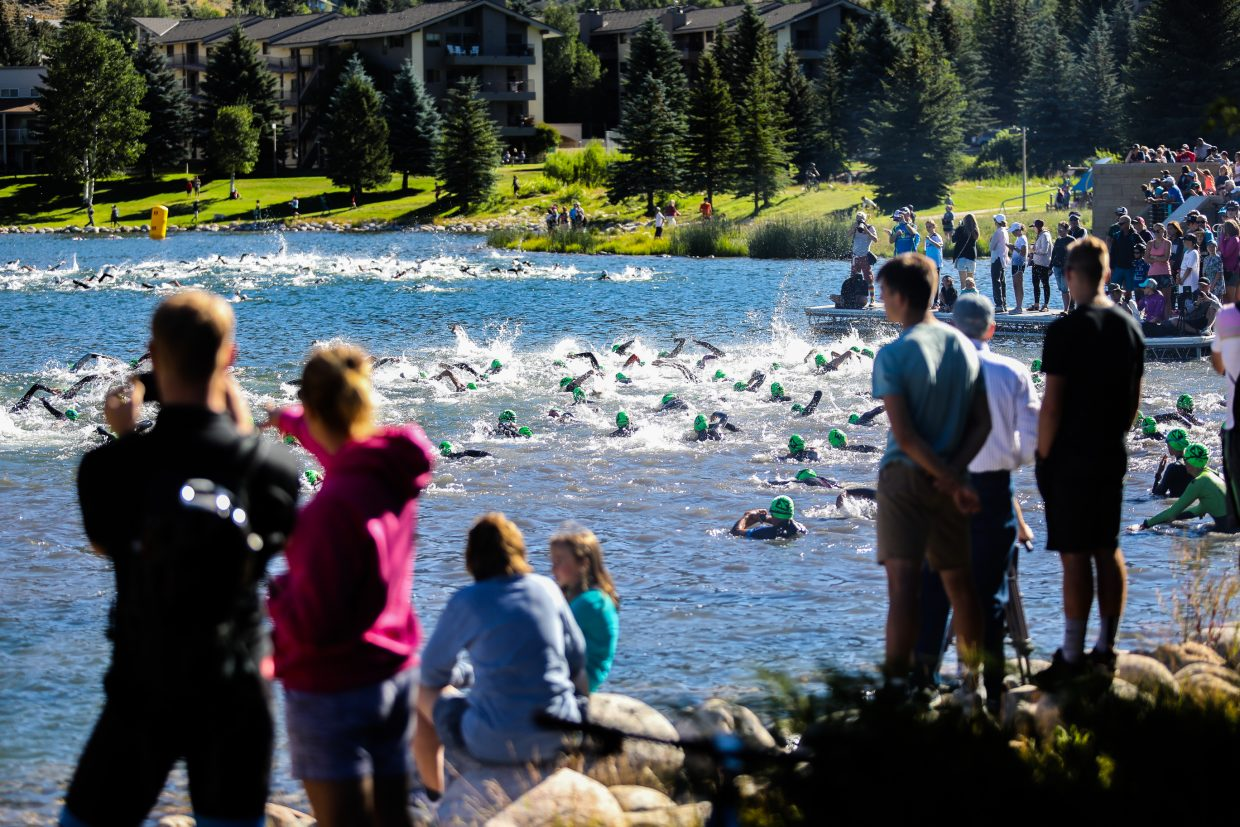 Racers begin the swim during the Xterra Beaver Creek Saturday, July 15, at Nottingham in Avon.